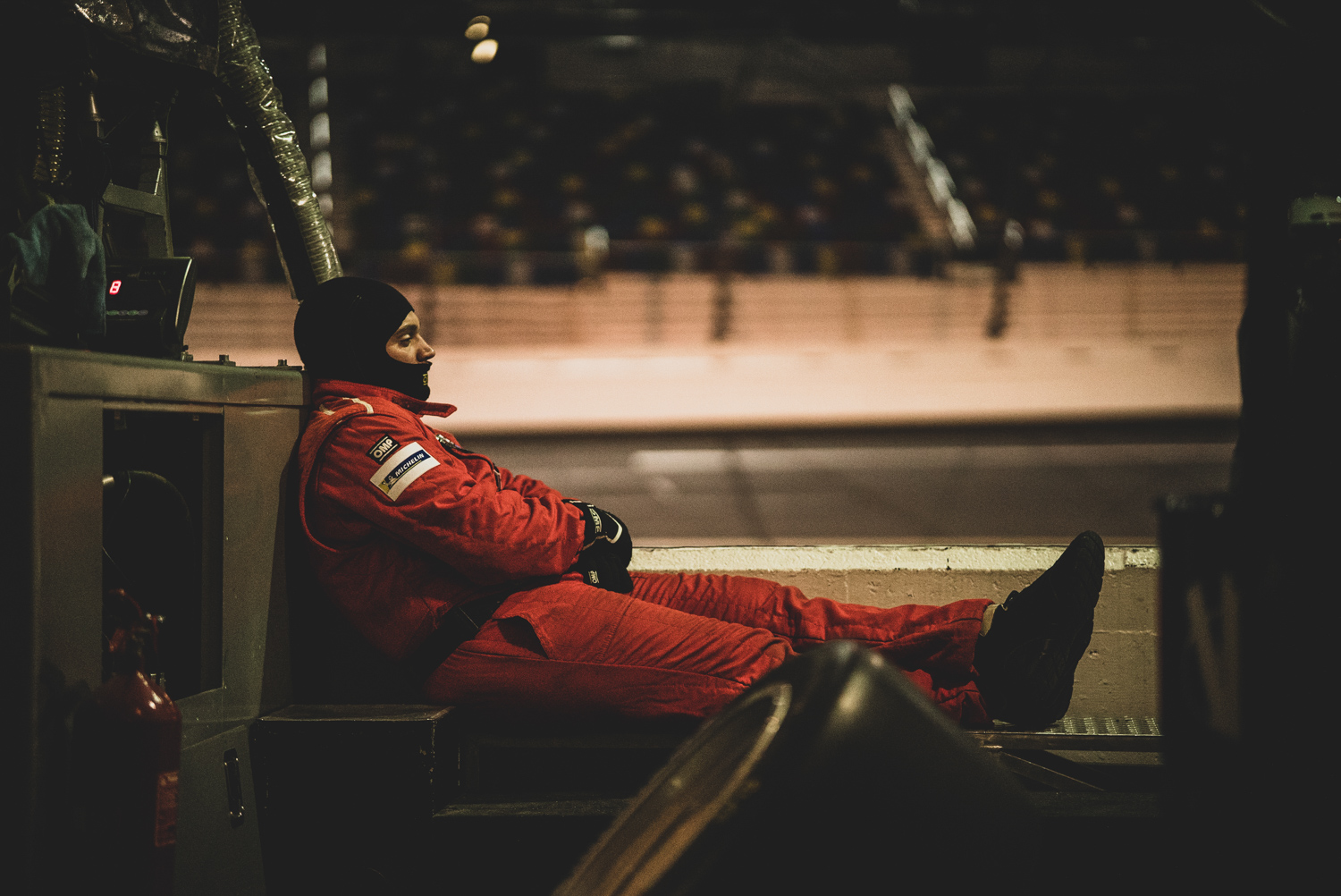 This pit crew member knows it's crucial to find time to rest during the marathon of racing.