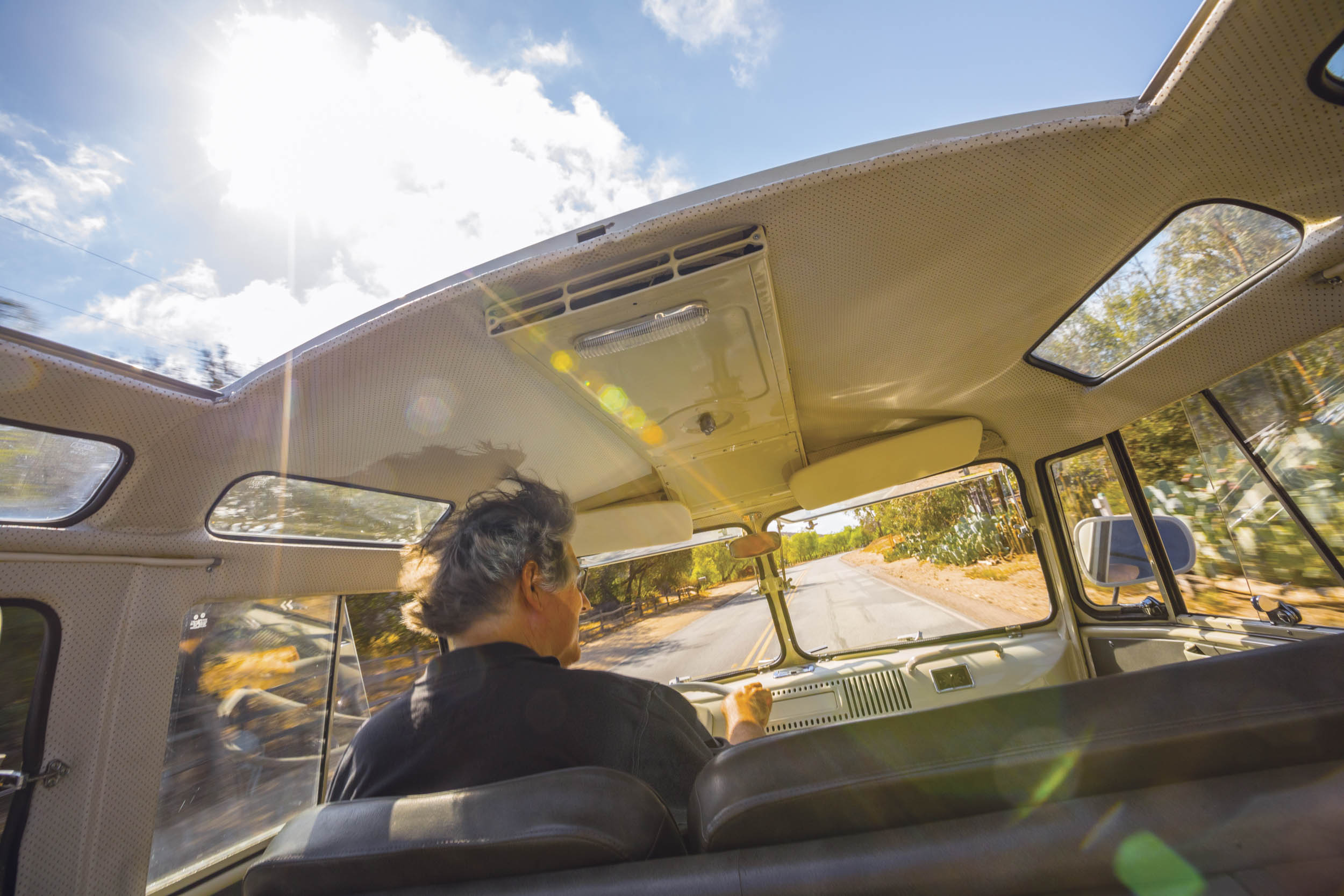 Zelectric Motors founder David Benardo basks in the sun in a 21-window VW Microbus with an 85-hp electric motor in place of the stock fourbanger.