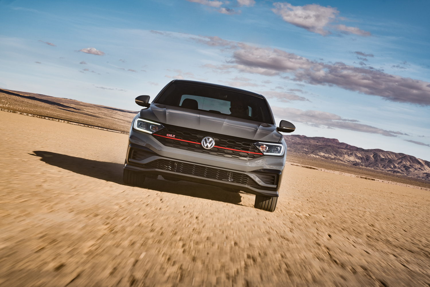 2019 Volkswagen Jetta GLI front end driving at speed