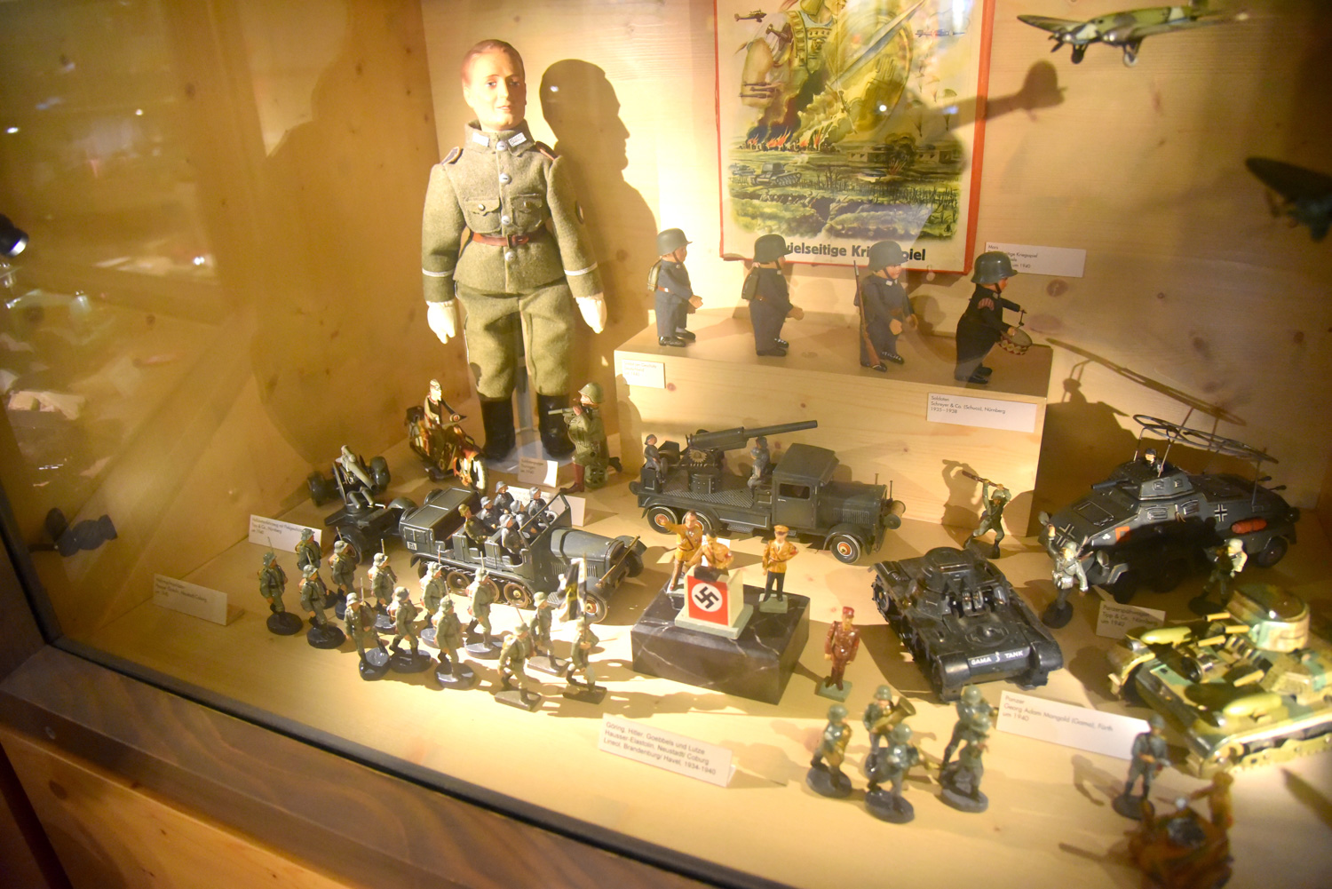 Among the vast collection is a small display of Third Reich-era toys that includes a figurine set of the Nazi leadership.