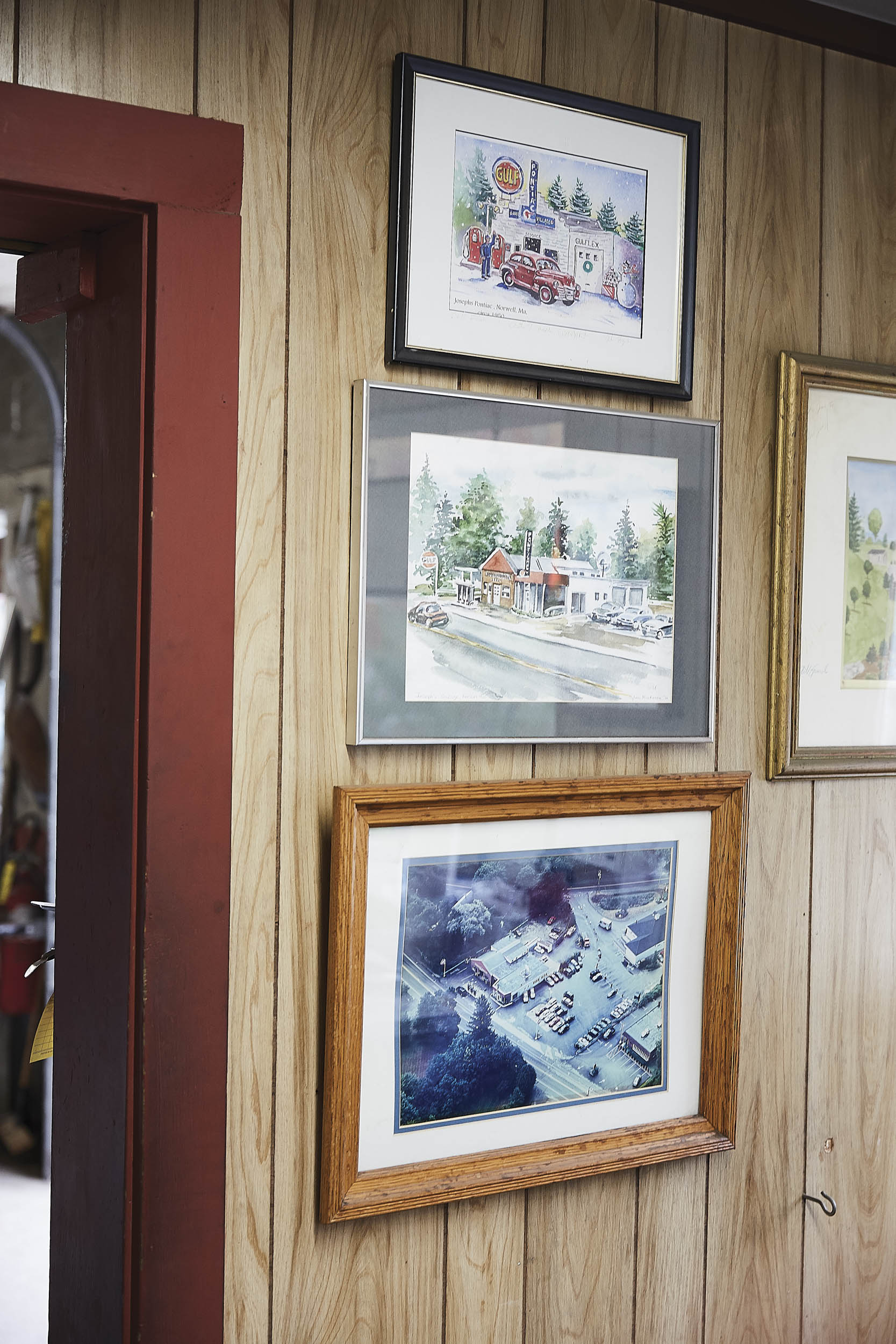 Photos and paintings of the dealership hang on a wall in the small office, reminders of Joseph's long history.