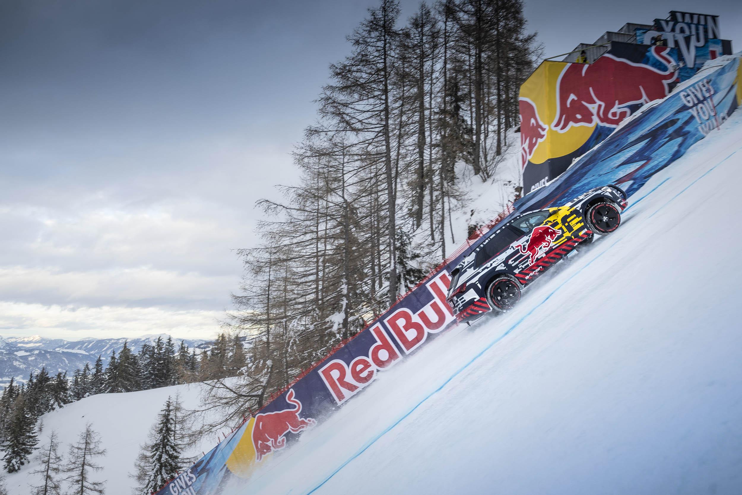 Audi e-tron extreme climbing a snow covered hill