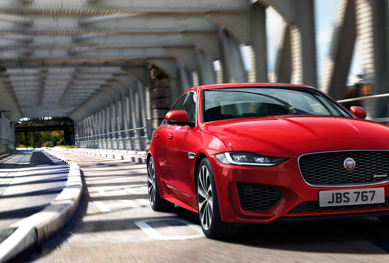 2020 Jaguar XE driving across a bridge