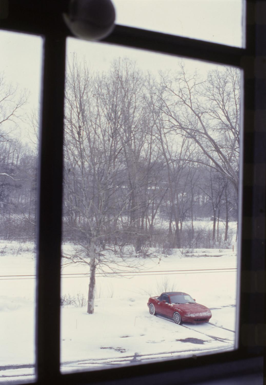 snow covered na miata winter window