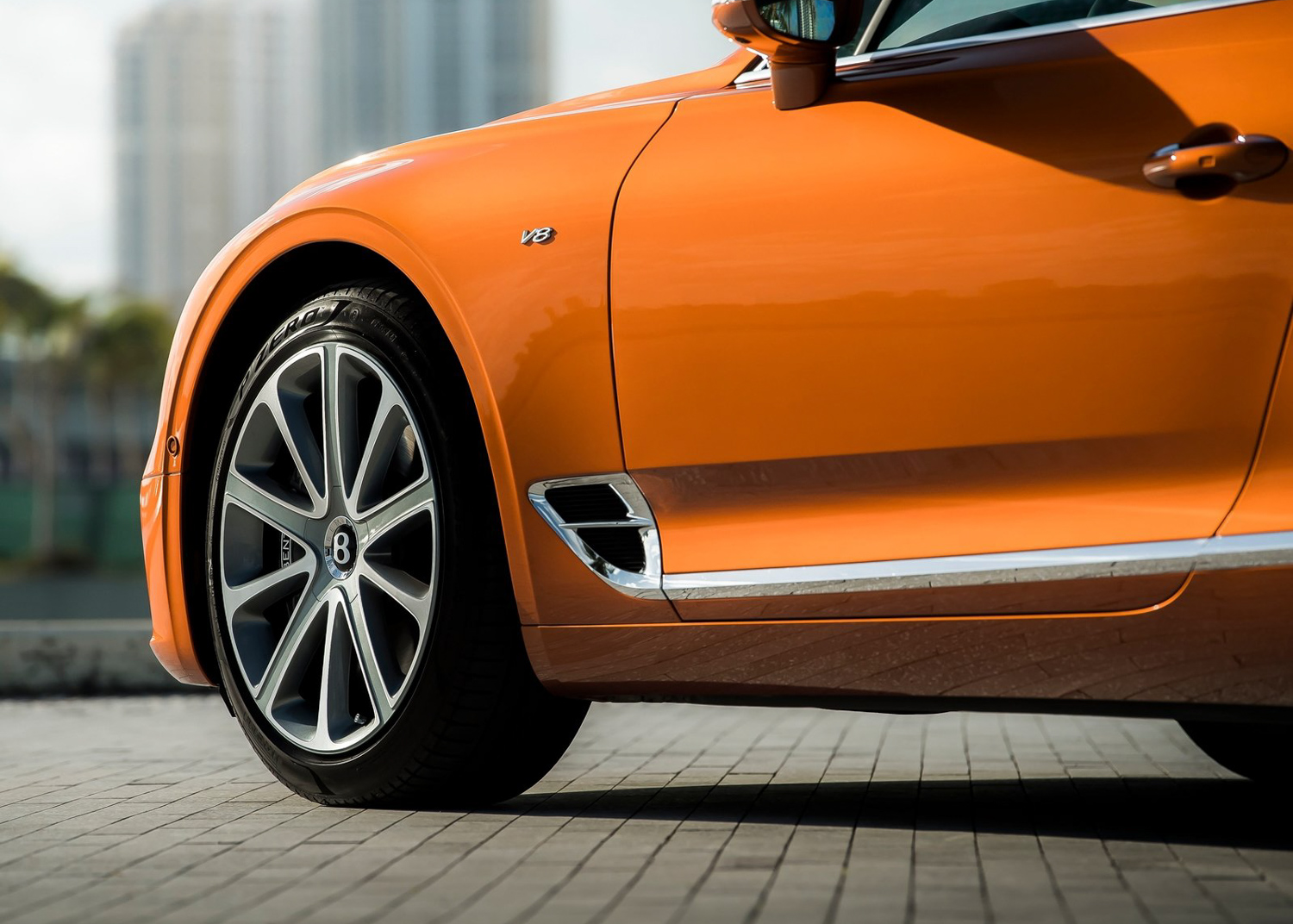 2020 Bentley Continental GT V8 coupe orange quarter pannel front