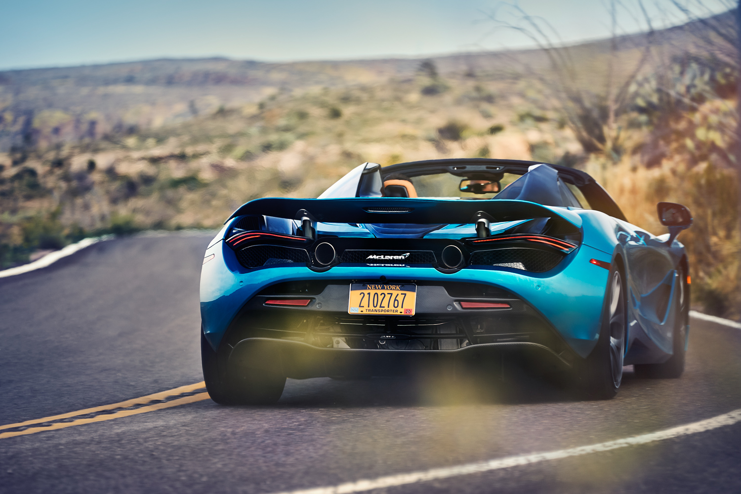 McLaren 720S Spider 3/4 rear curv on road