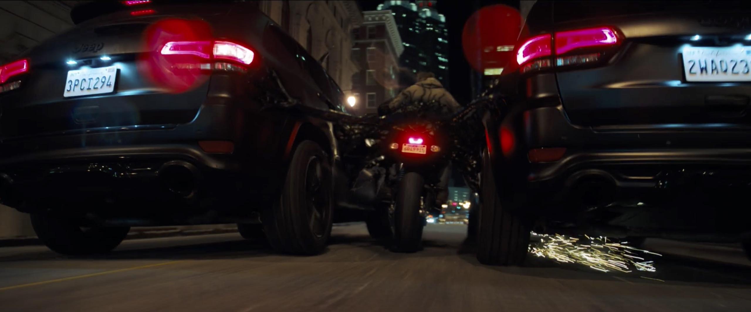 venom bike chase pushing jeep suvs
