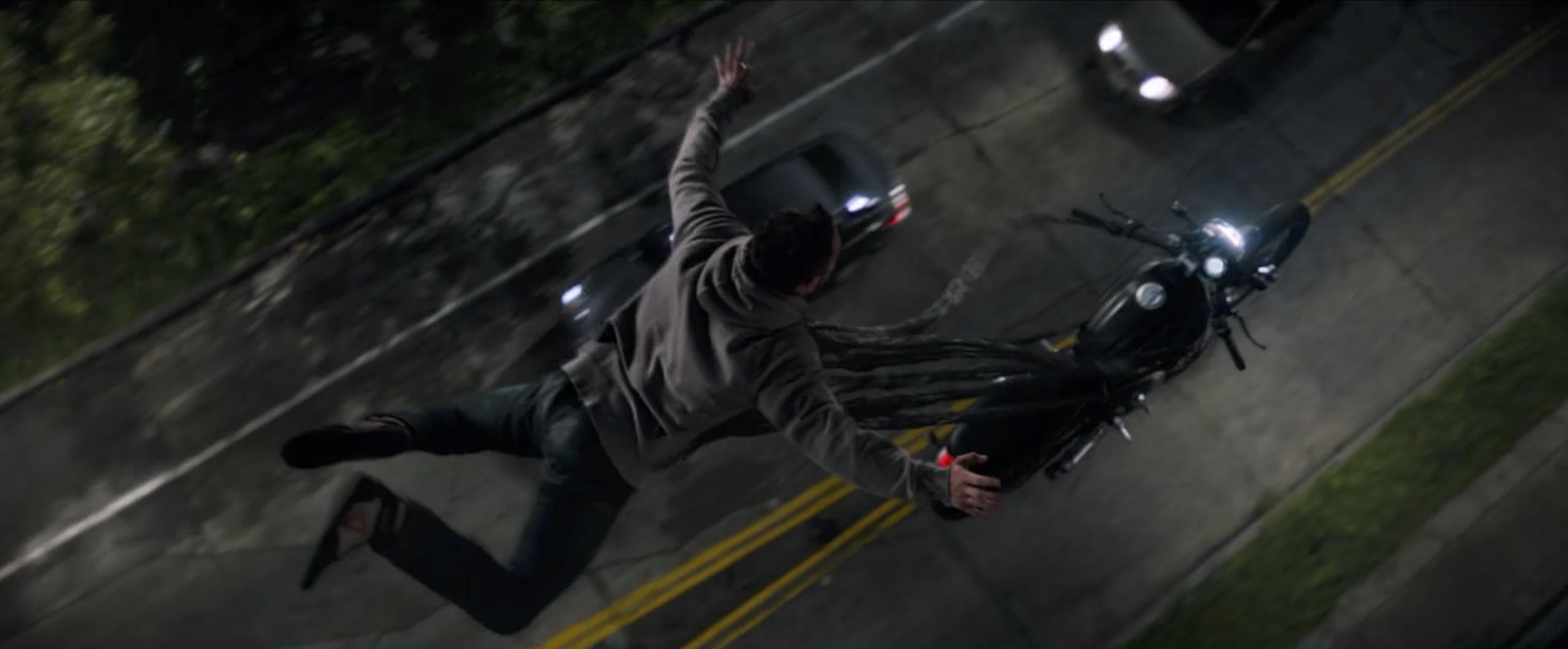 venom tom hardy flying above motorcycle