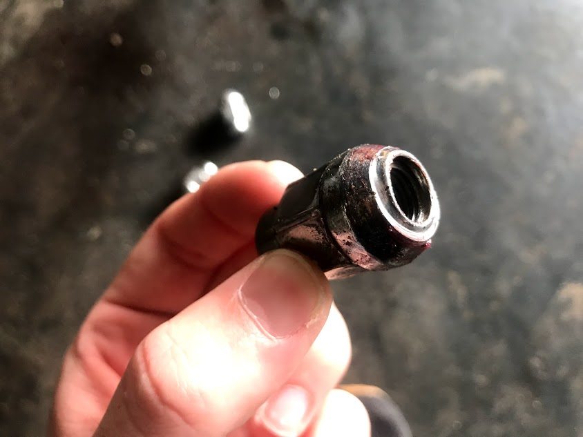 Damaged lugnut Corvair wheel stud
