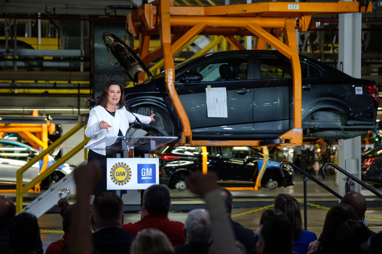 Michigan Governor Gretchen Whitmer addresses the gathering Friday, March 22, 2019, after it was announced GM is investing $300 million in its Orion Township, Michigan, assembly plant to produce a new Chevrolet electric vehicle that will bring 400 new jobs to the plant.