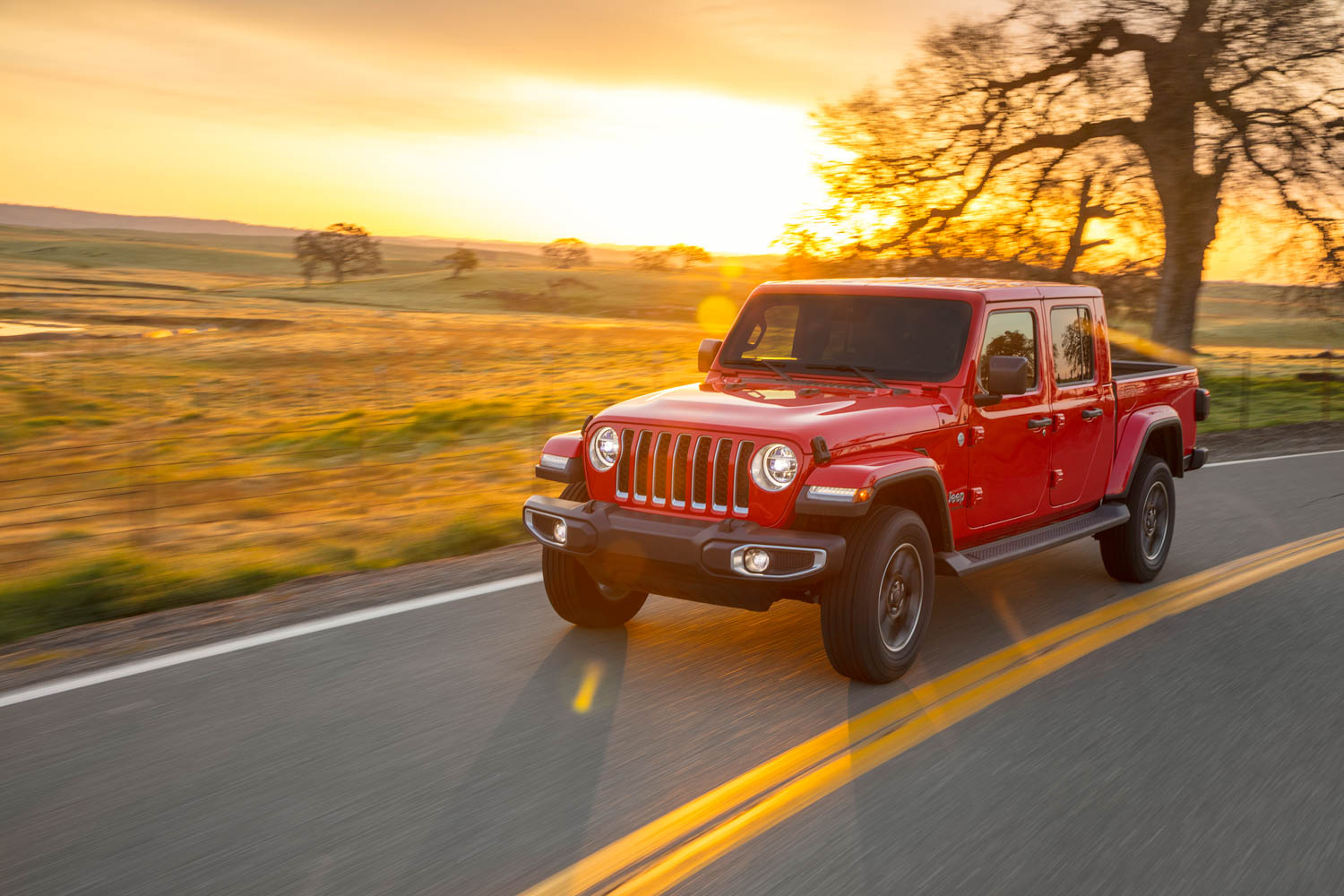 Red 2020 Jeep Gladiator Rubicon at sunset
