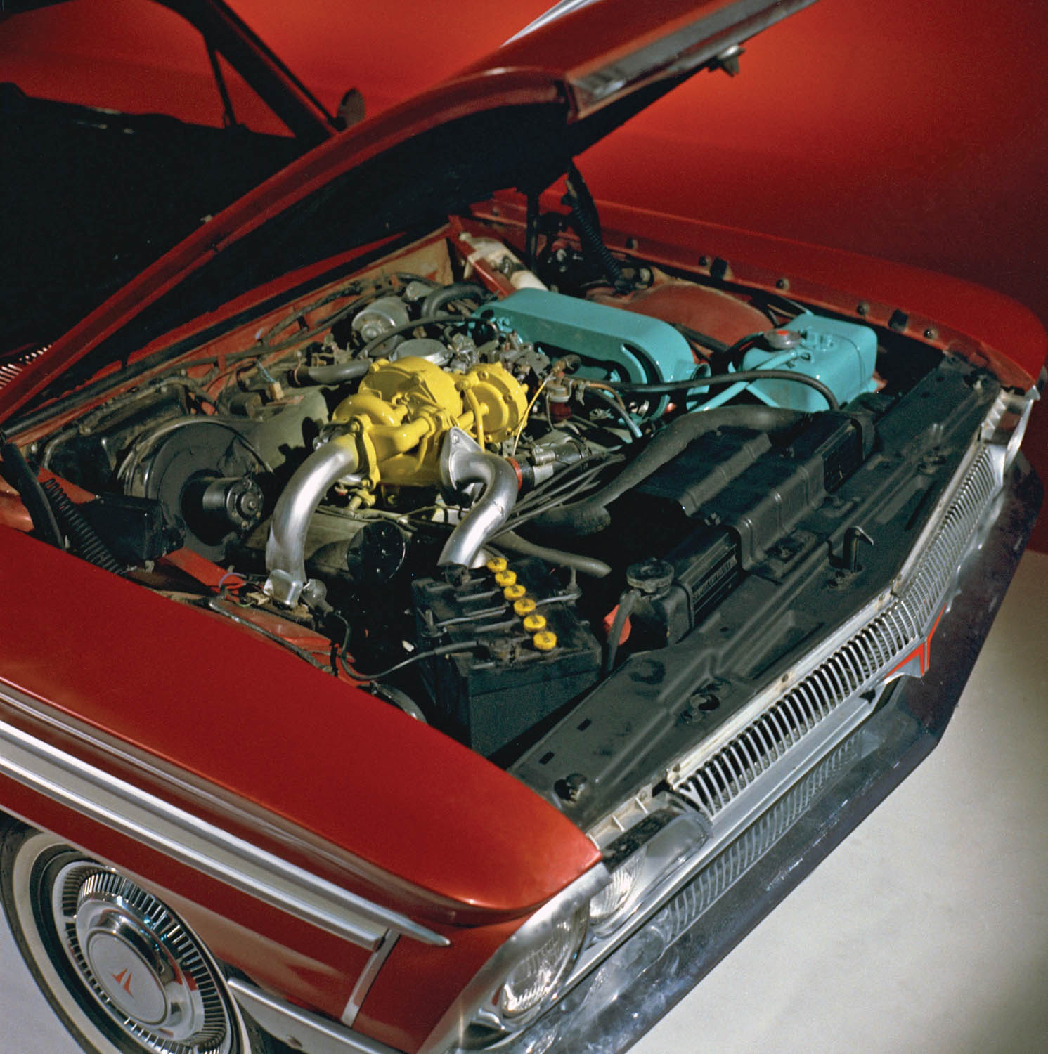 Oldsmobile's 1962 Jetfire Turbo Rocket V-8 was topped by a Garrett AiResearch turbocharger fed by a single-barrel Rochester side-draft carburetor. Five psi of boost raised output to 215 horsepower at 4800 rpm and 300 pound-feet of torque at 3200.