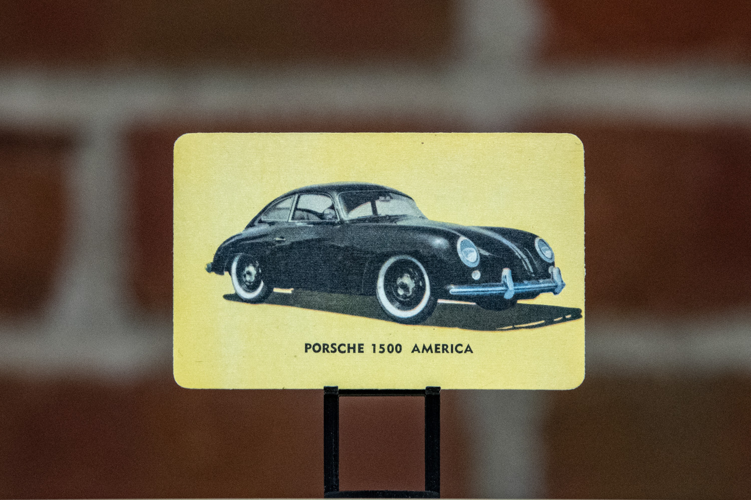 The first card in the set is a Porsche 1500 America.