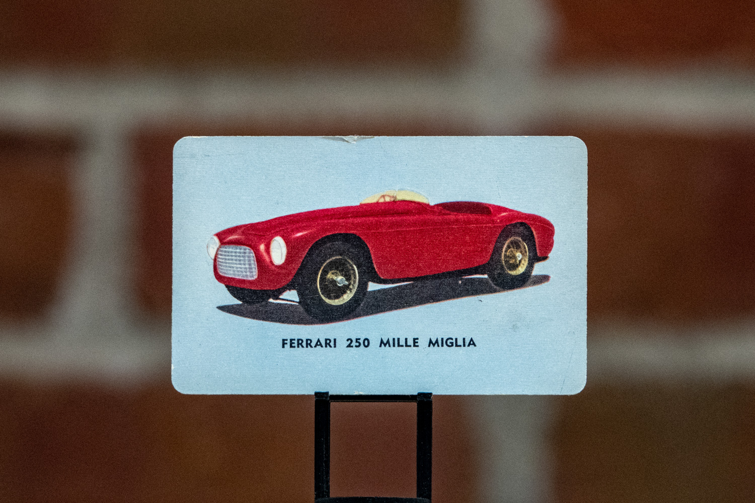 Considering that the cards were included in packages of cookies, finding one without a flaw—this Ferrari 250 Mille Miglia card has a dent at the top, for instance—can be difficult.