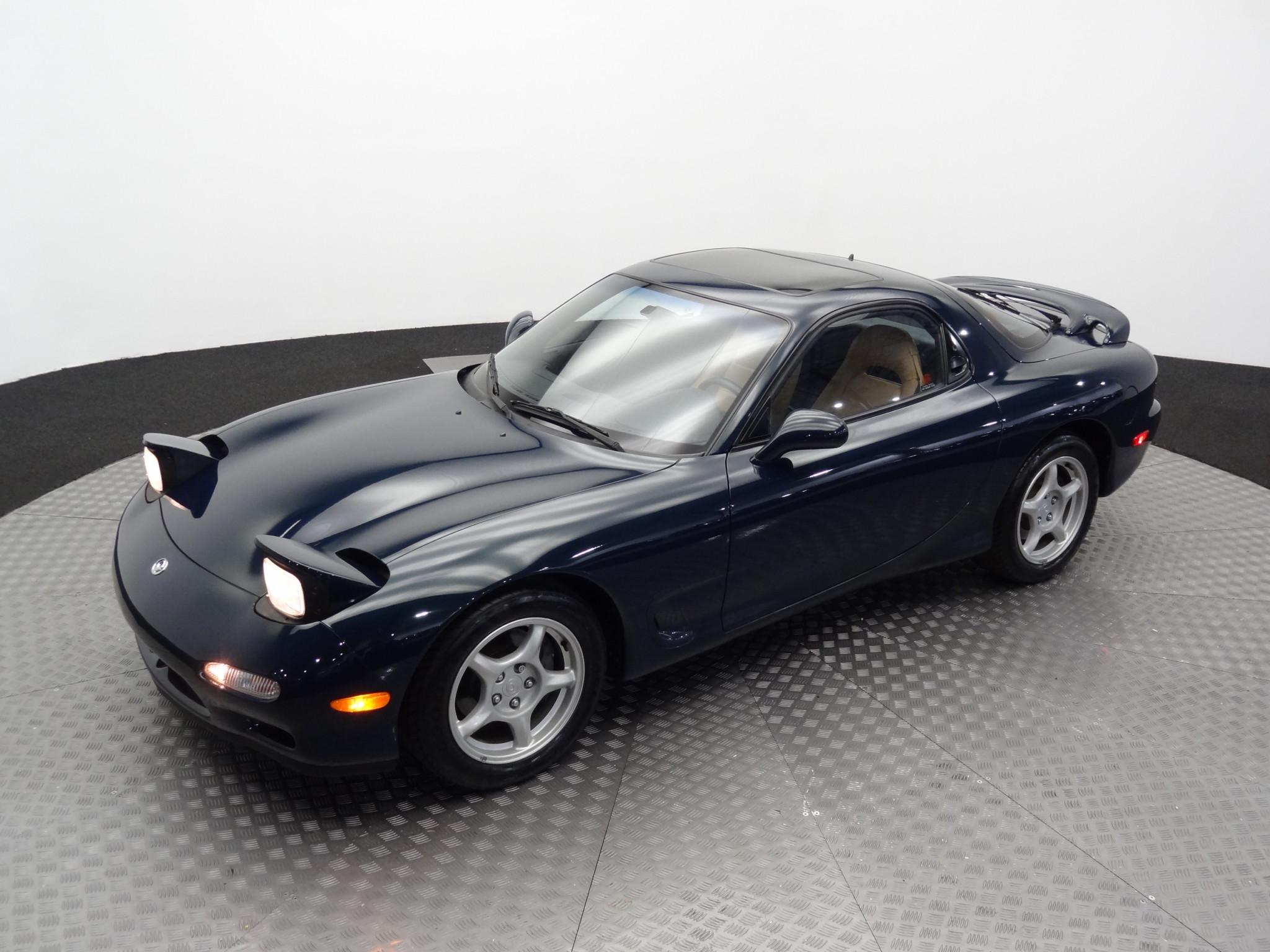 1994 Mazda RX-7 3/4 front lights up