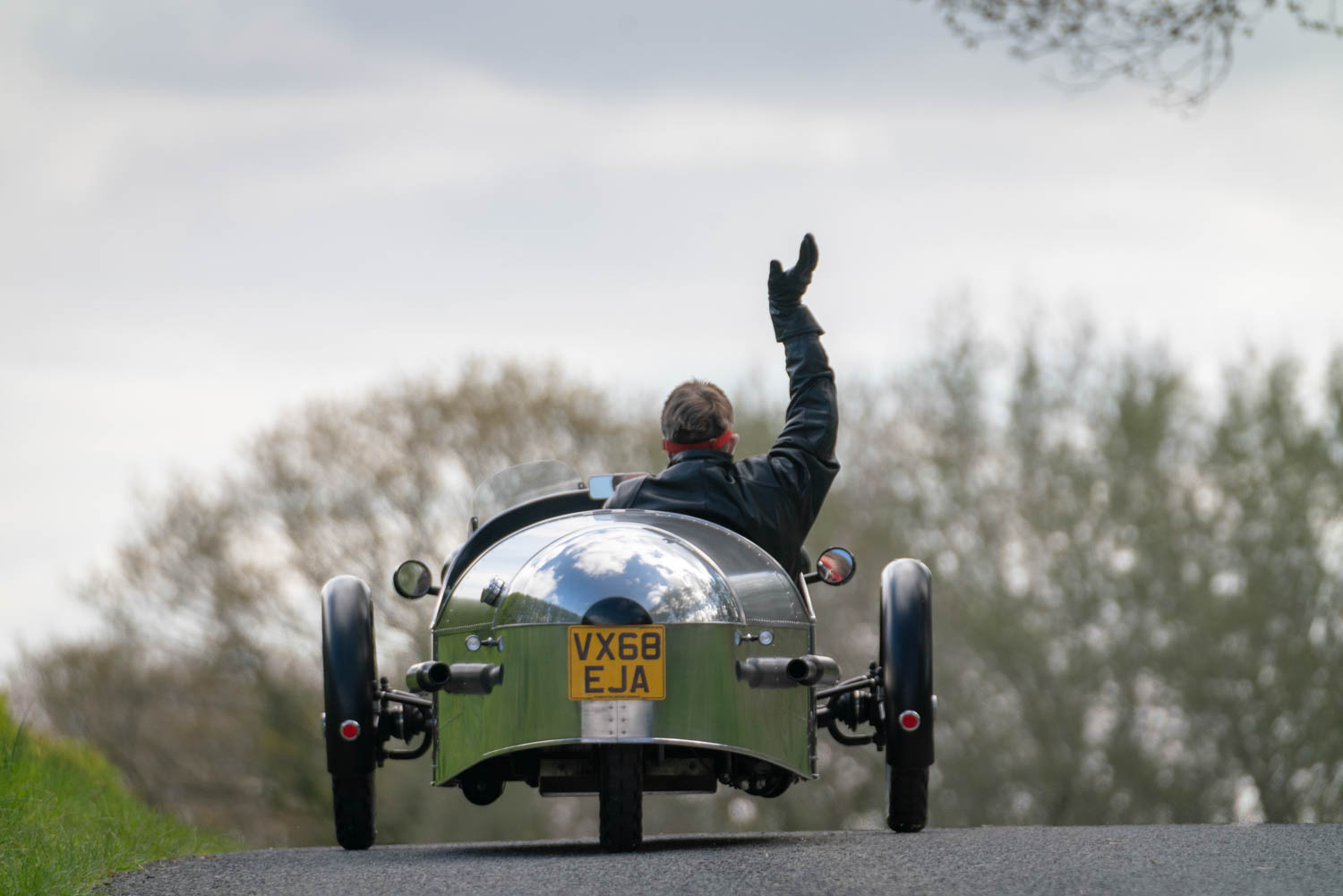 Pembleton V-Sport waving while driving