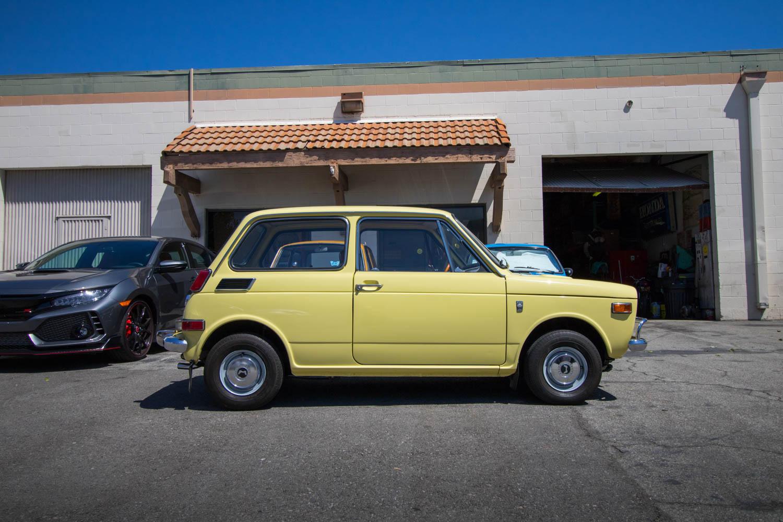 yellow Honda N600 side profile
