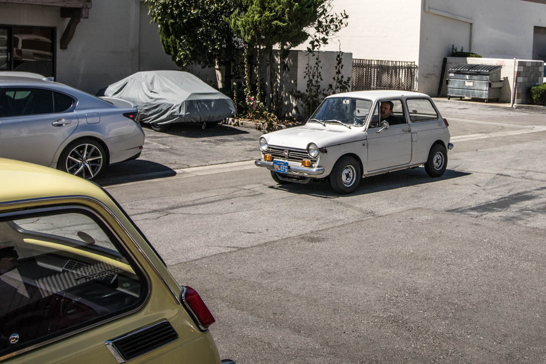 white Honda N600 parking lot