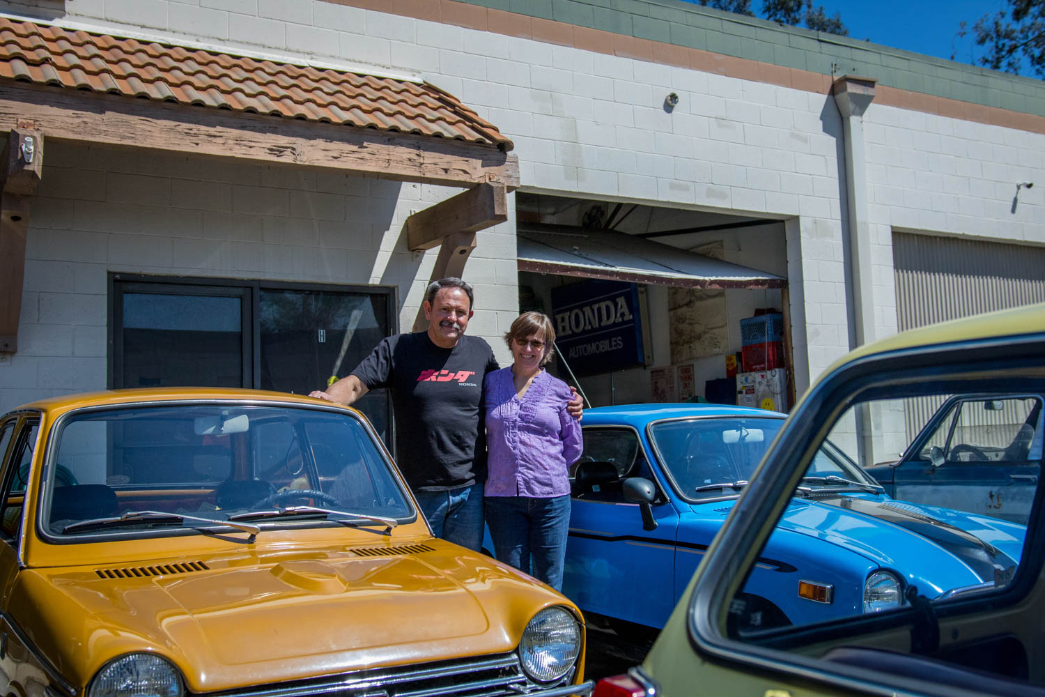 Tim Mings and wife infront of his shop