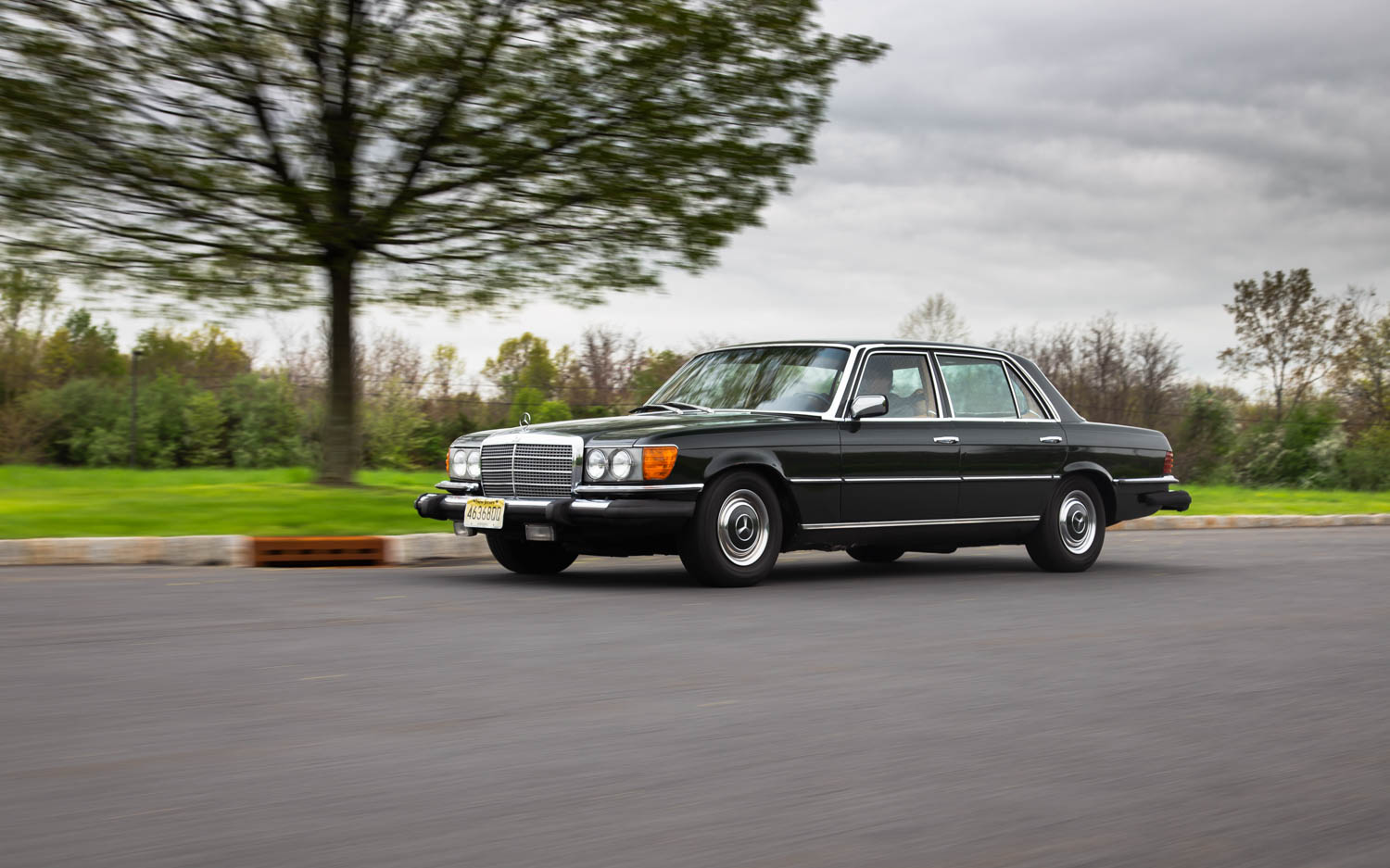 green 1974 Mercedes-Benz 450SEL driving