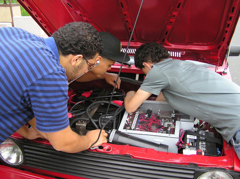 working under the hood on the Volkswagen EV Rabbit