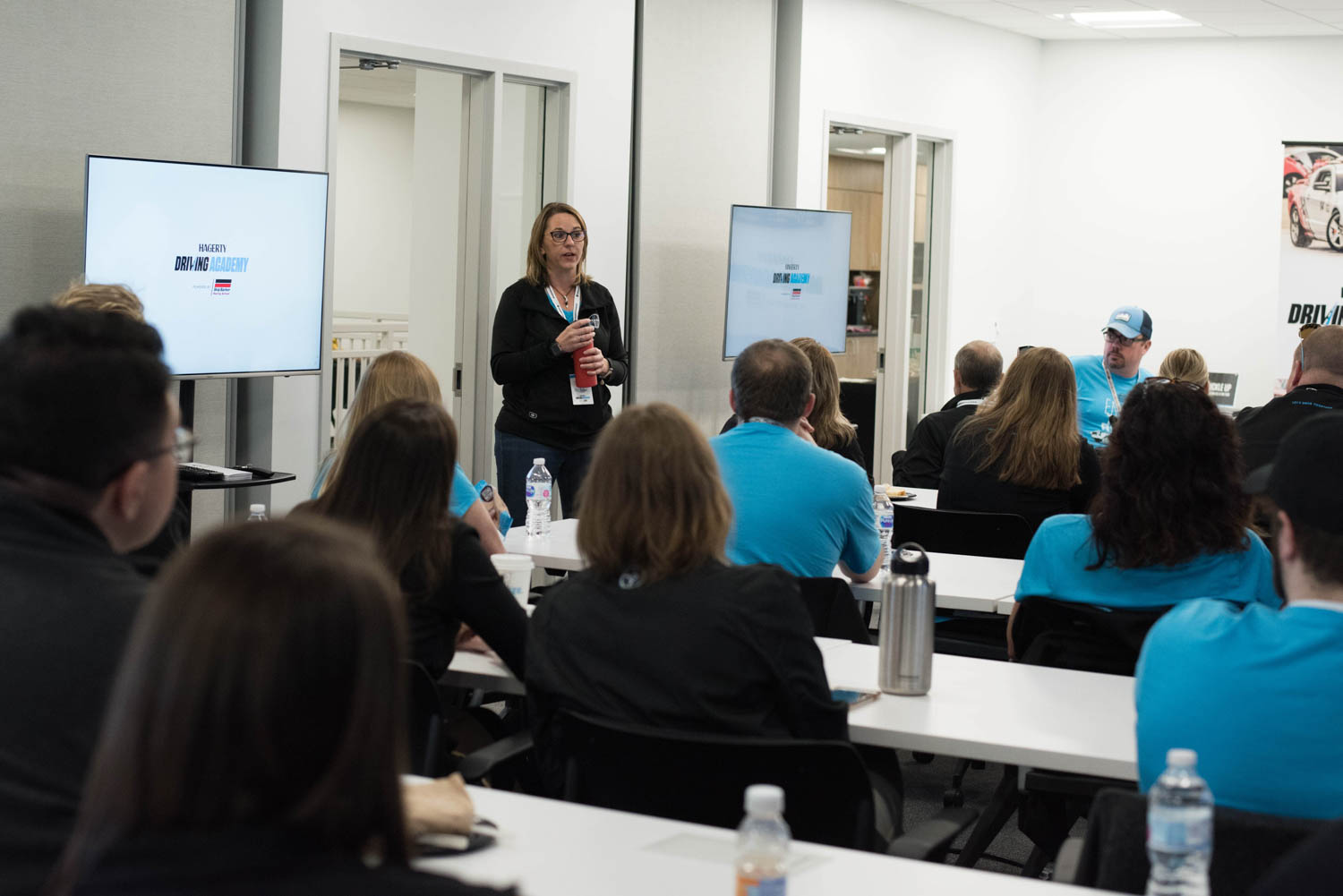 Tabetha Hammer, Hagerty's Senior Manager of Car Culture, speaks to the group before the class was split into teams