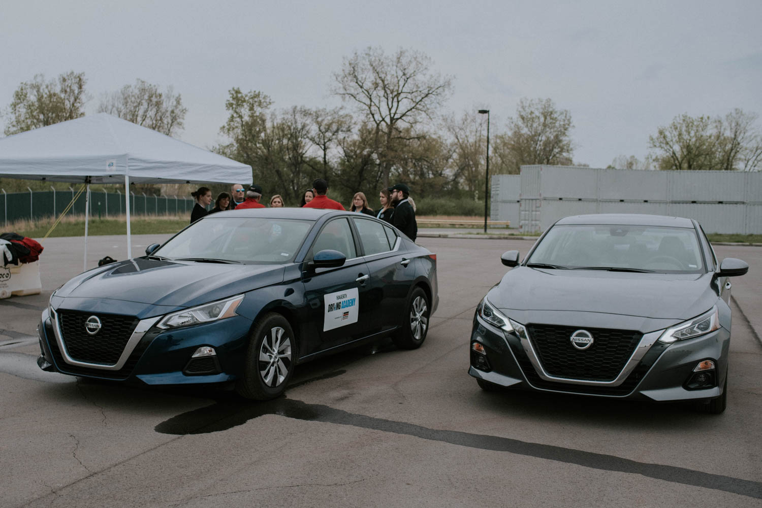 A pair of Nissan Altimas await students at the skid pad