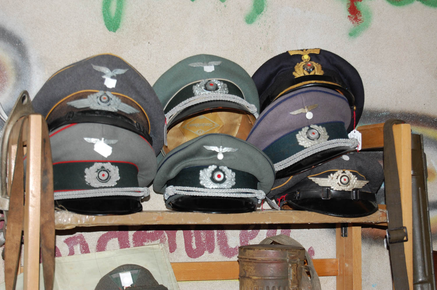 German officer caps, likely reproduction, line the shelves of a swap meet for military knickknacks and jeep parts at Vierville-sur-Mer near Omaha Beach.