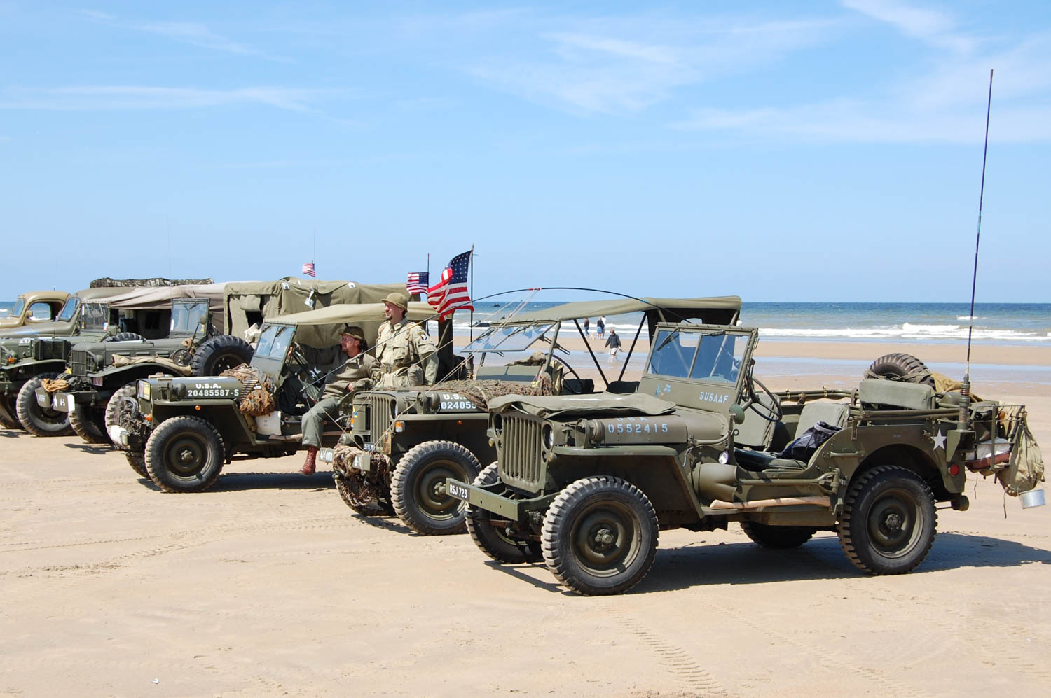 Jeeps gather at low tide in the infamous Dog Green sector of Omaha Beach, depicted in the opening sequences of Saving Private Ryan.