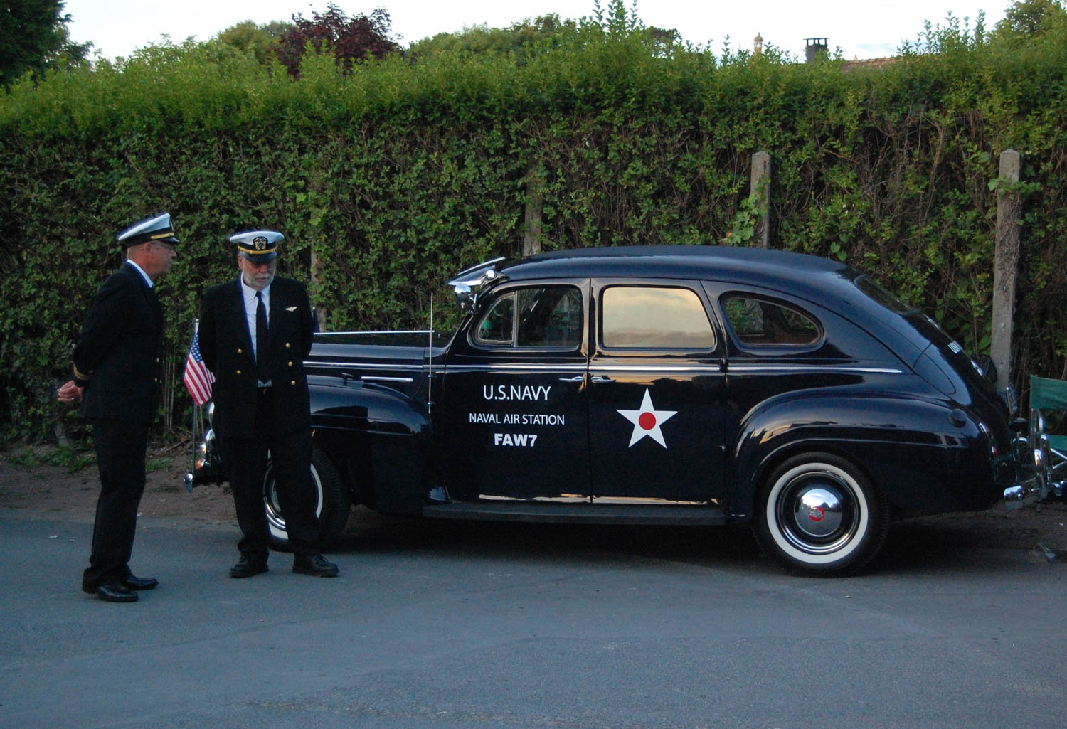 A Plymouth Navy staff car waits to drive onto the beach at Arromanches.