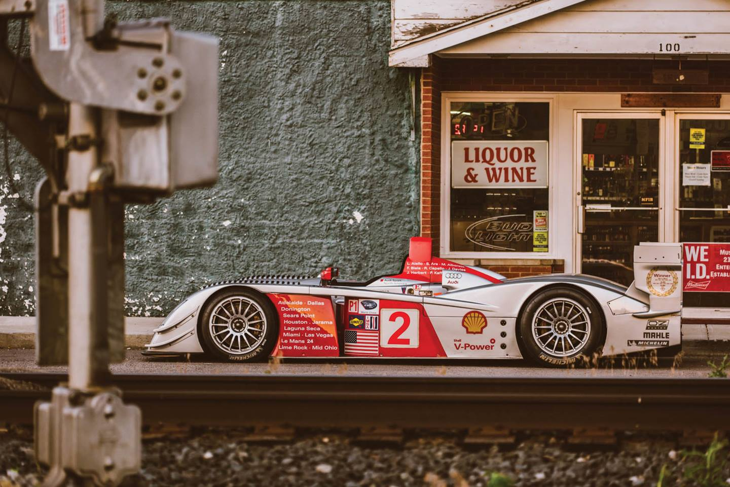 This small-town liquor store is a long way from home for this Audi R8 that finished third at Le Mans in 2005, helping privateer team Champion Racing become the first American squad to win the race since Ford in 1967.