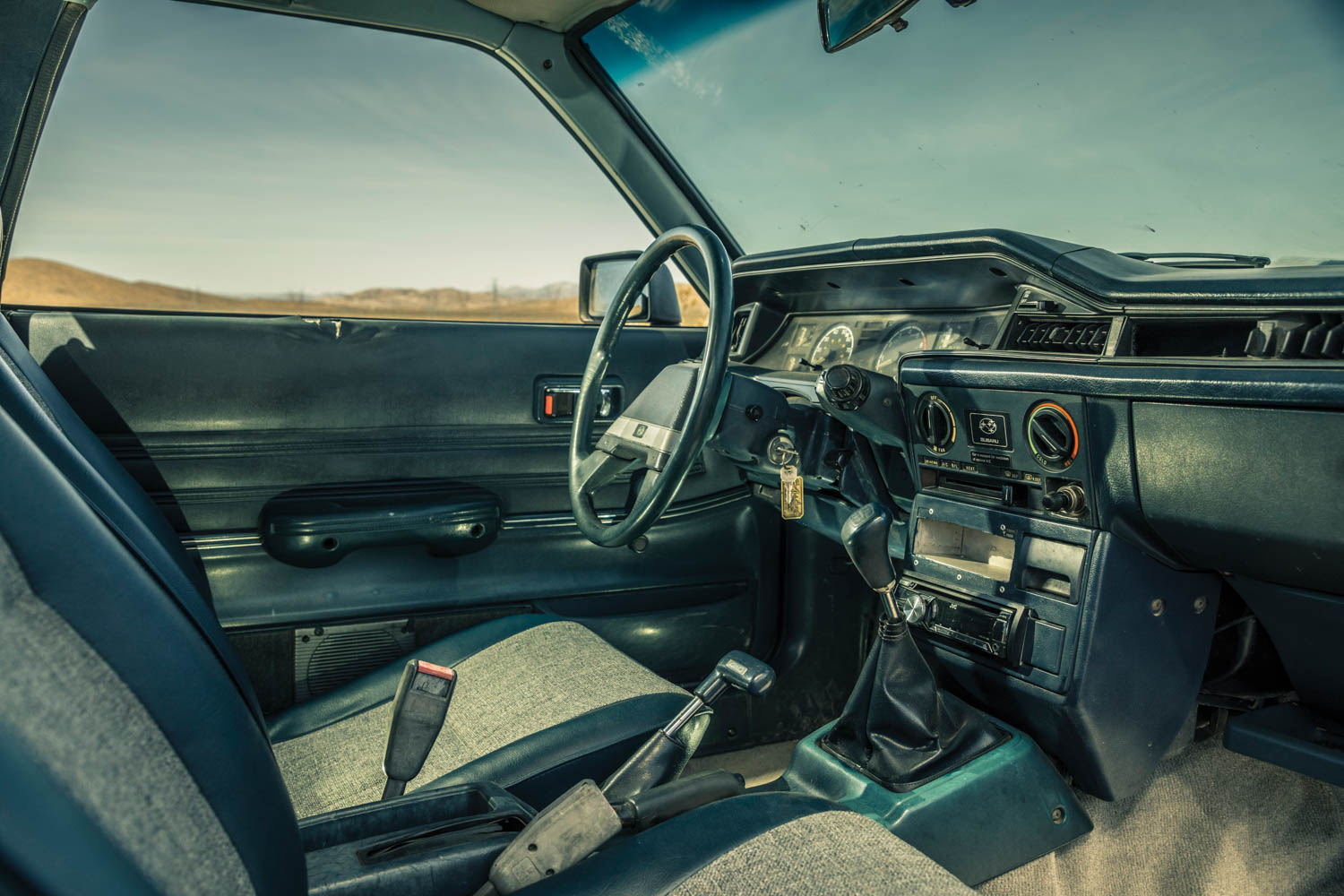The Subaru dash (far left) bears the scars of homemade improvements.