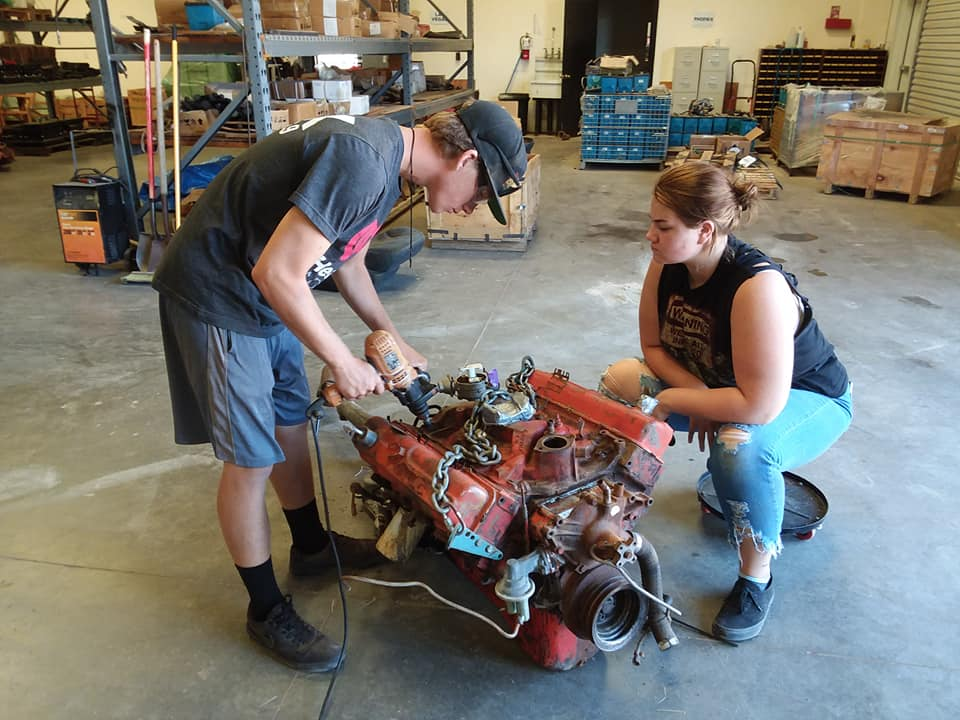 kids working on the engine