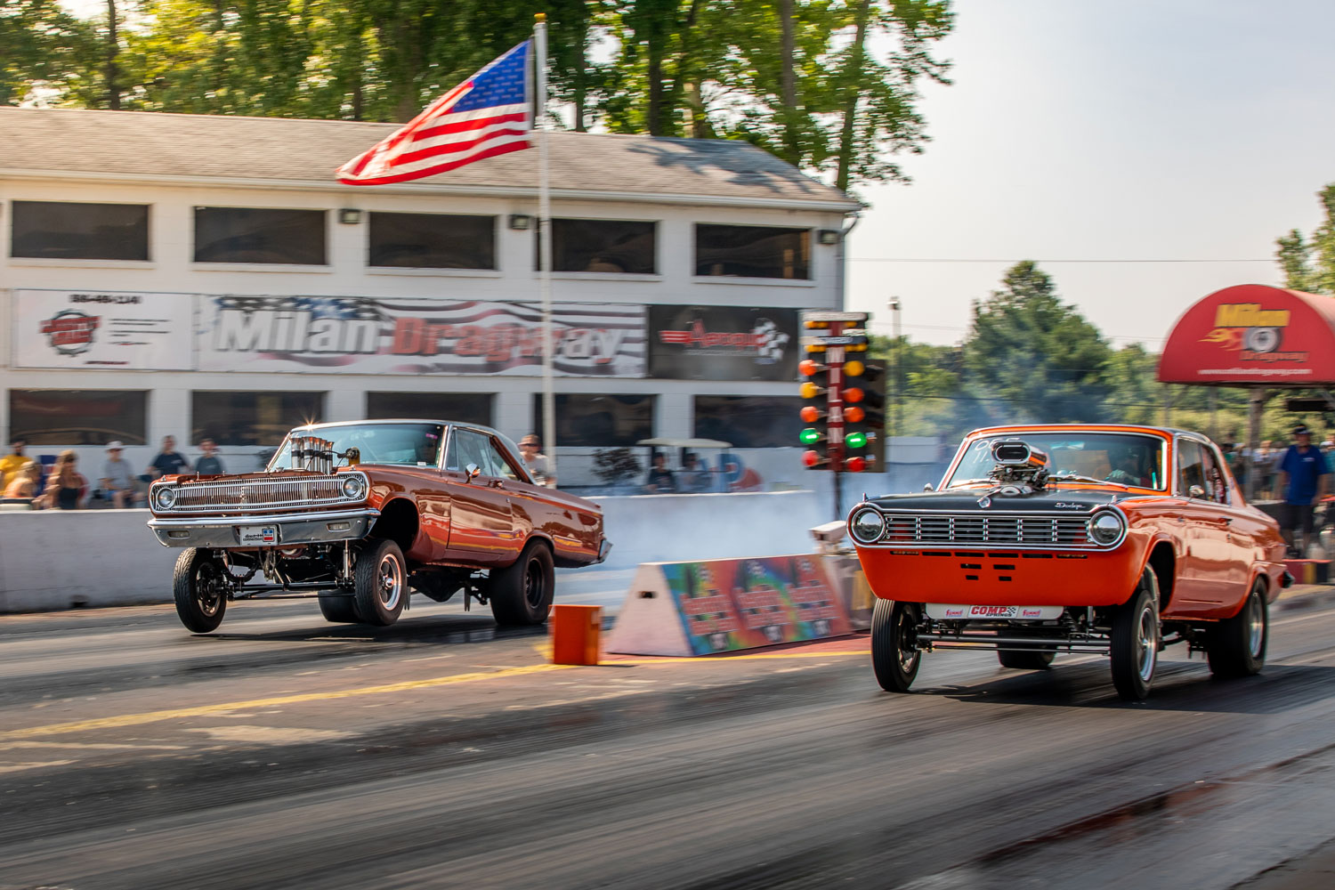 dueling altered drag cars
