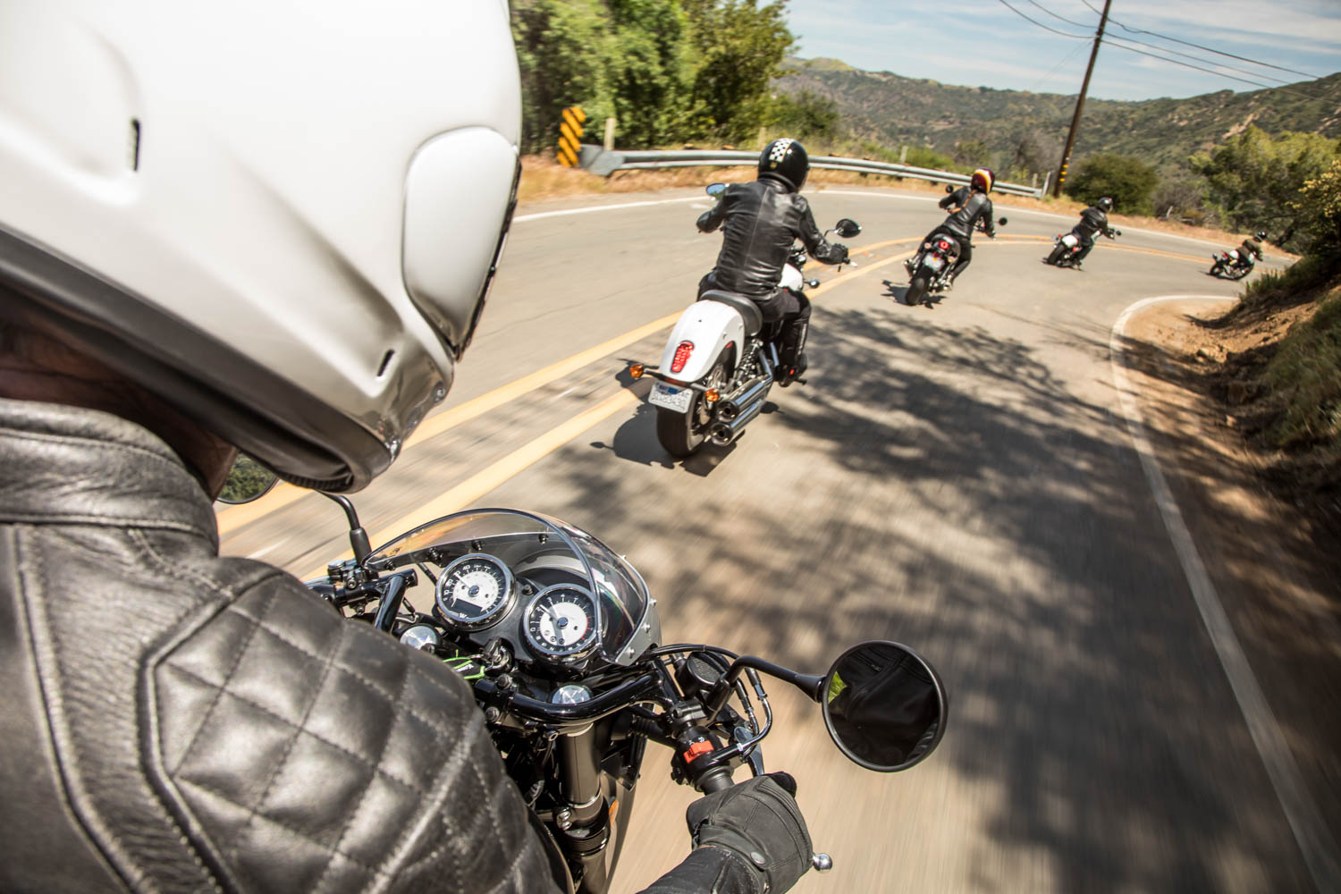 Leaning into the turn on a glorious California two-lane is one of the great pleasures in motorcycling. From left to right, the Kawasaki W800 Cafe, the Indian Scout Sixty, the Triumph Street Twin, the Harley-Davidson Sportster Iron 1200, and the Royal Enfield Continental GT.