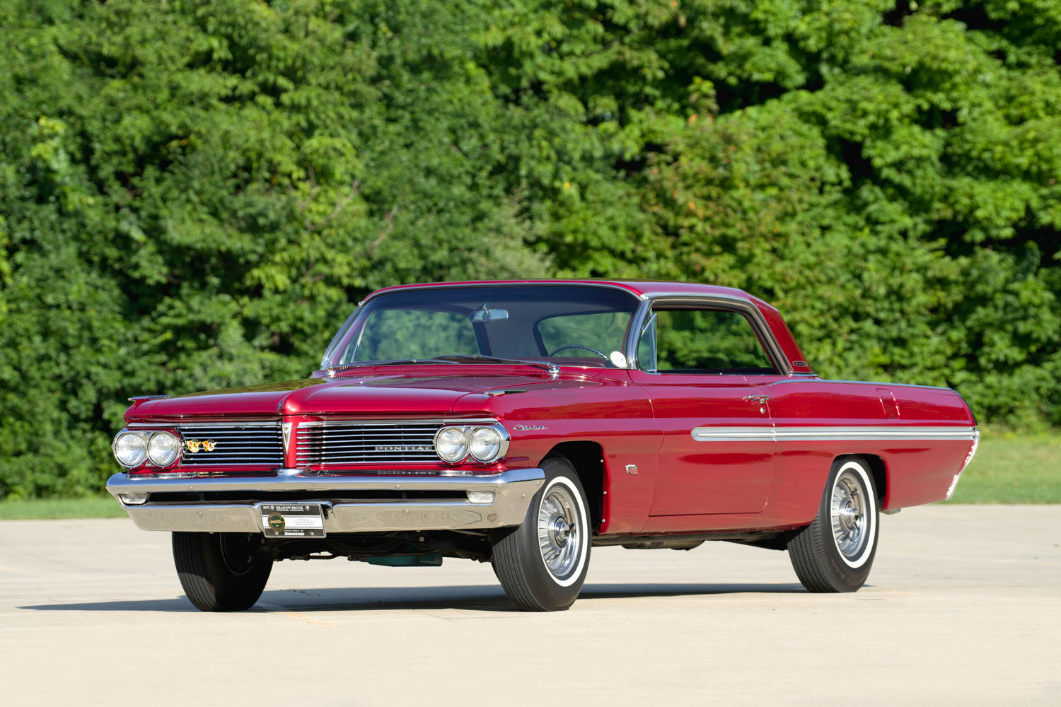 Finished in Belmar Red, the Koss '62 Pontiac Catalina is a striking automobile. The painted body cove identifies it as a Royal Bobcat.