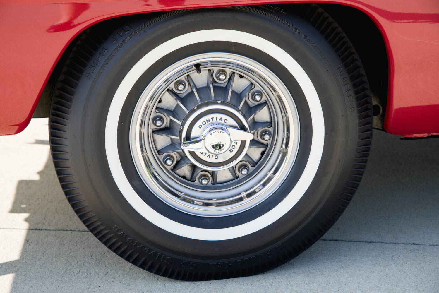 The eight-lug wheels were a Super Duty option in '62. The now-rare spinners were a Bobcat add-on.