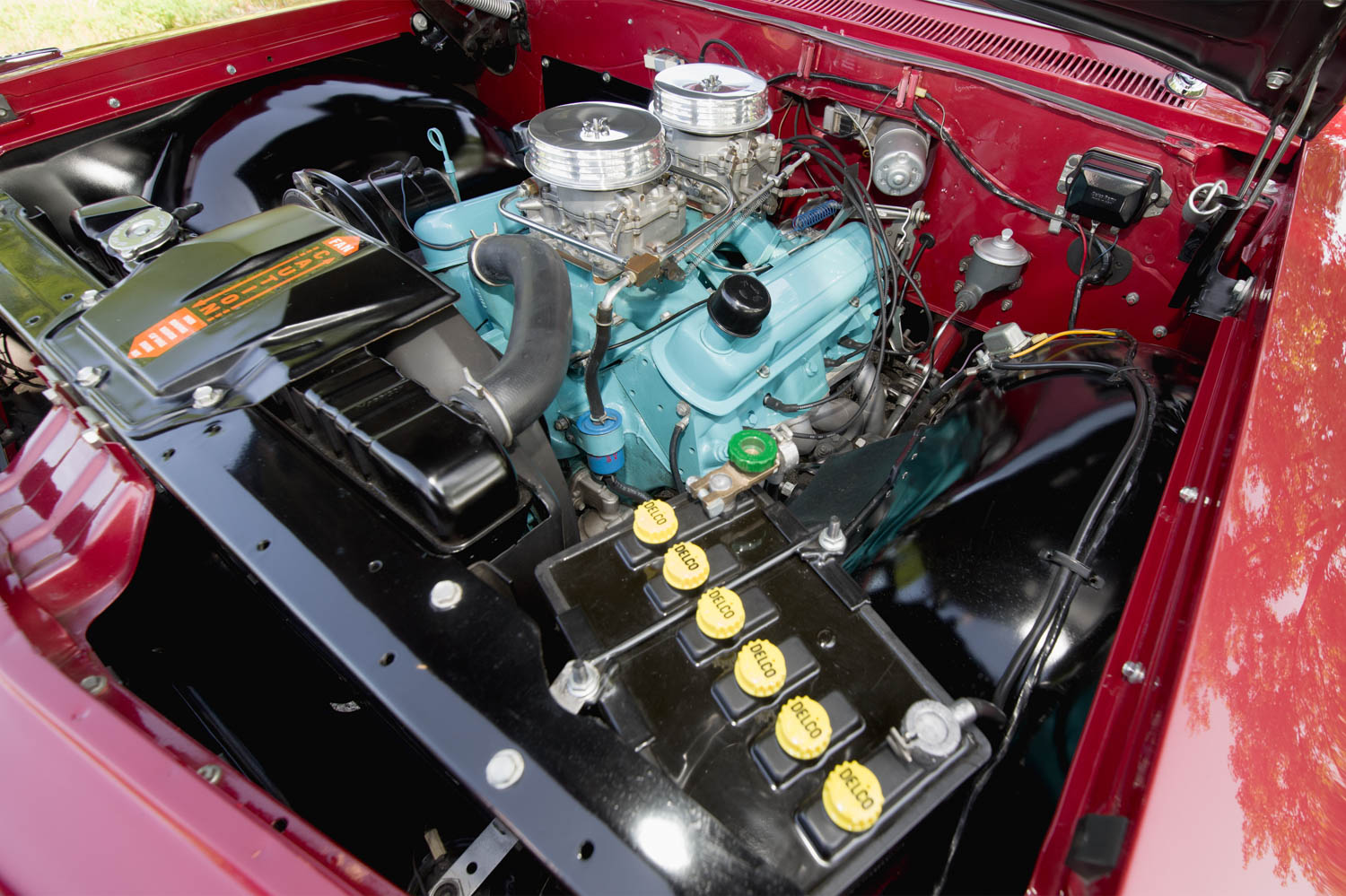 The engine compartment of this concours Catalina is beautifully finished. A period-correct battery cranks the high-compression 469-cubic-inch Pontiac engine.