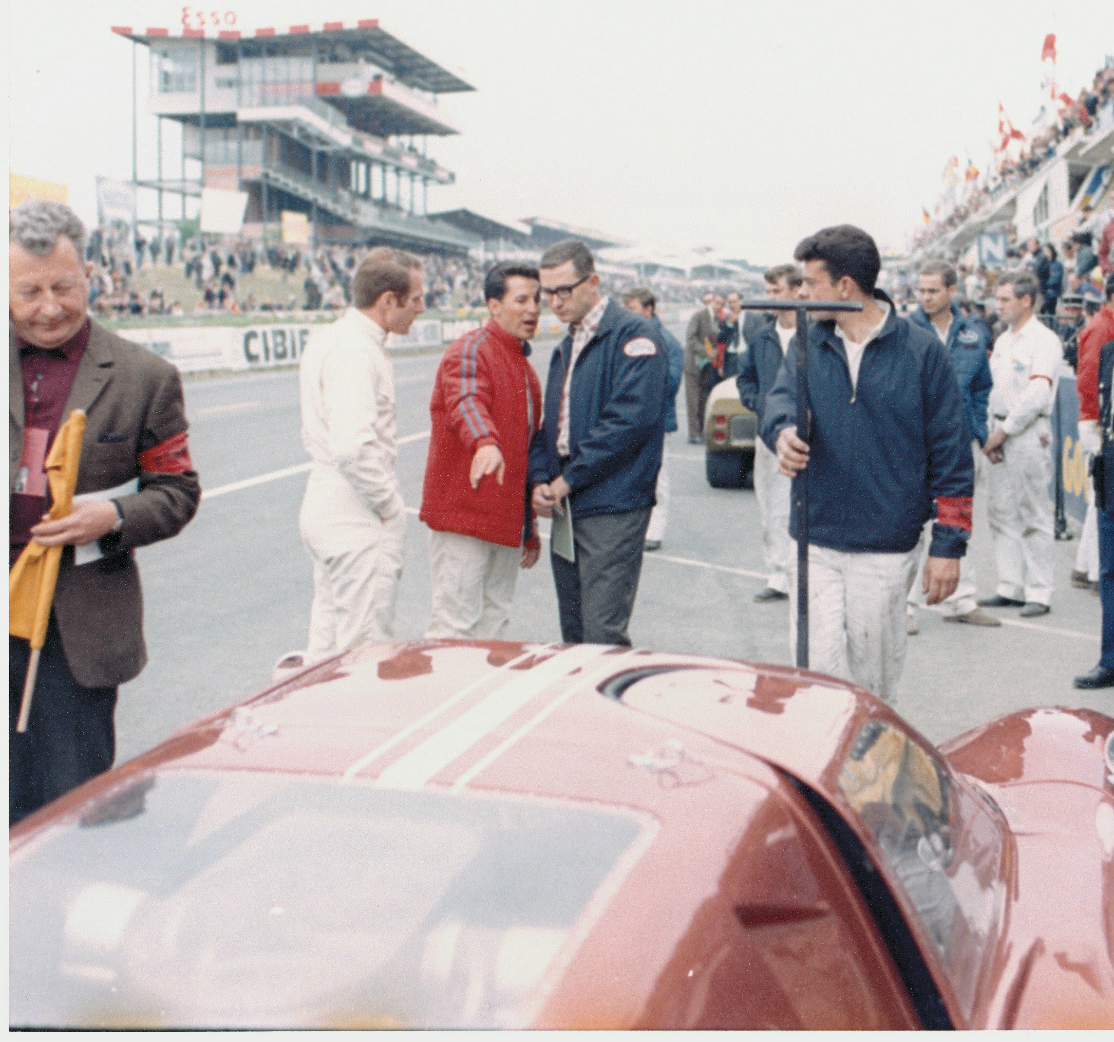 Mario Andretti (in the red jacket) talks to Holman & Moody team manager John Wanderer while co-driver Lucien Bianchi listens in. Mike Teske Archives/Ford Motor Company
