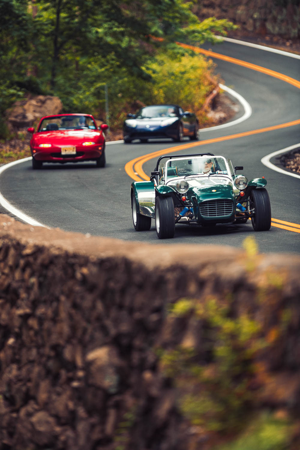 Much like the original Lotus 7, Elan, and Elise that inspired them, today's Caterham Seven, Mazda Miata, and Tesla roadster excel when the going gets twisty.