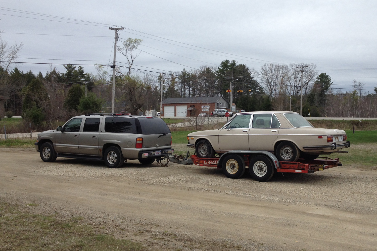 The oft-used combo of one of my Suburbans towing a U-Haul auto transport so I could bring my BMW Bavaria home.