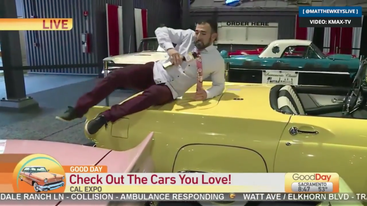 Newscaster fired after literally climbing onto the cars for auto show segment thumbnail