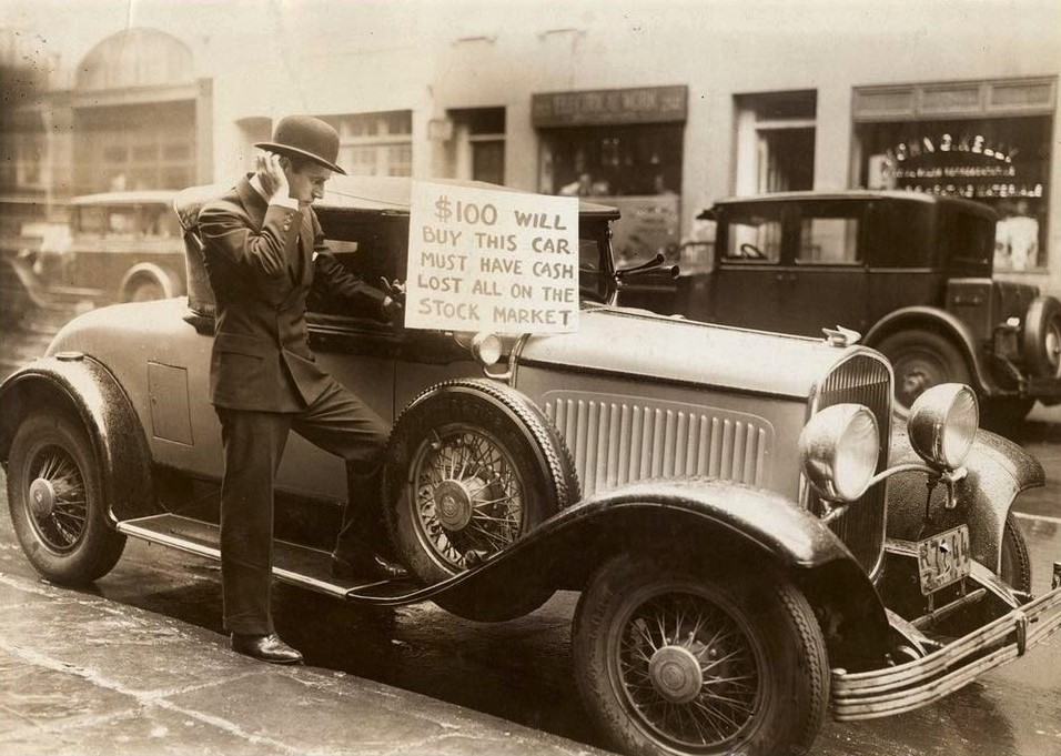 A news photo taken on October 30, 1929 shows investor Walter Thornton attempting to sell his 1928 Chrysler Imperial 75 Roadster for $100 in New York.