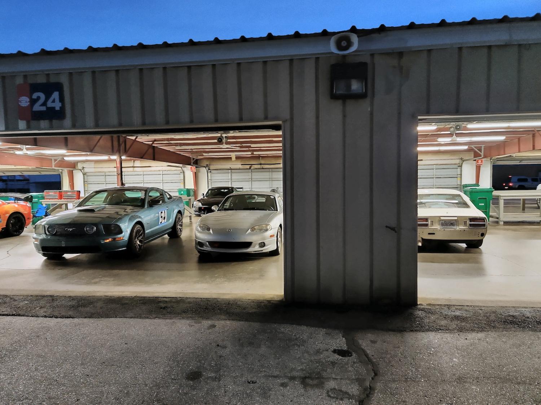 Racecars Garaged At Dusk