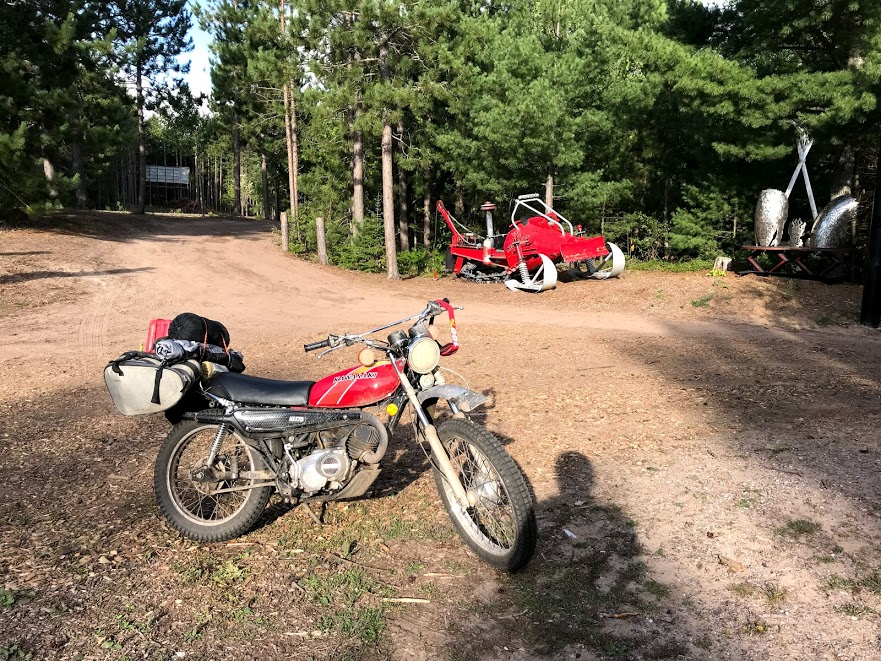 vintage kawasaki motorcycle at campground