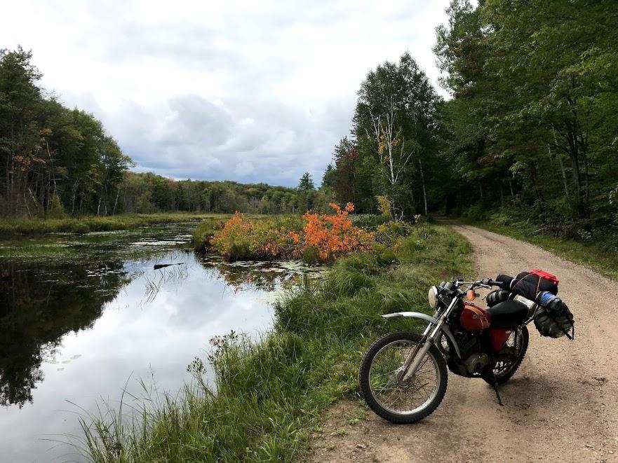 vintage kawasaki motorcycle parked lakeside