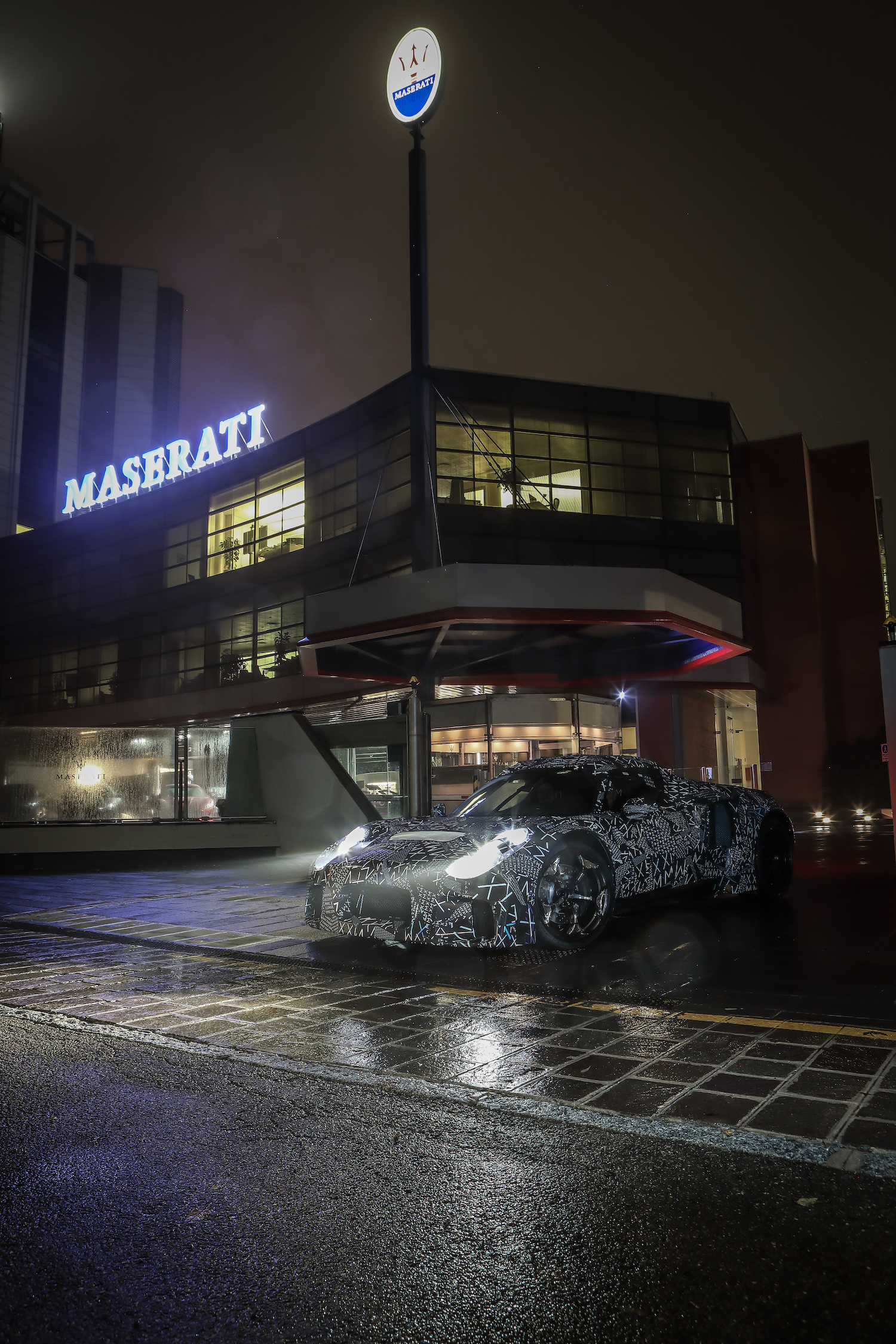 Camouflaged maserati on modena streets