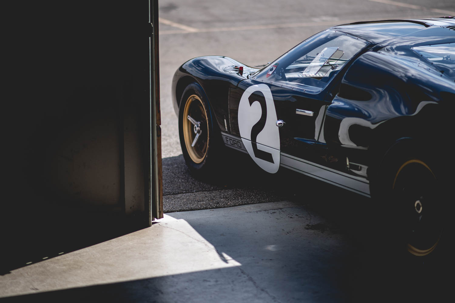 In 1966, Ford replaced the GT40's smallblock V-8 with the big-block 427, creating the Mark II. The larger engine required the scoops ahead of the rear tires.