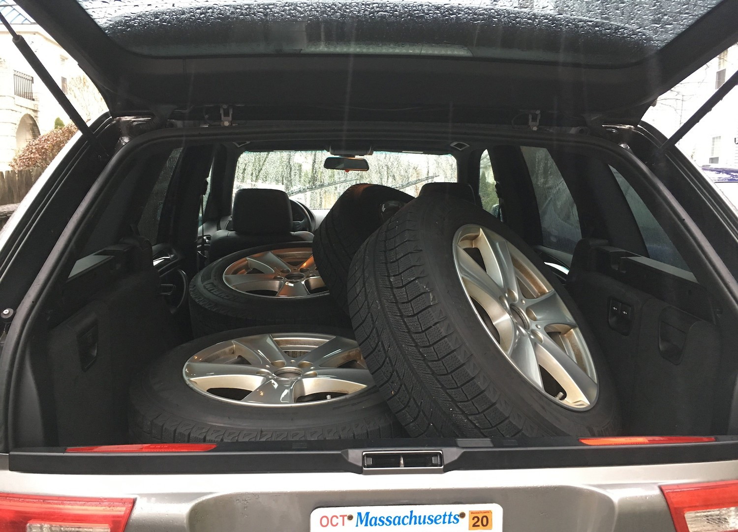 winter wheels and tires in open wagon trunk