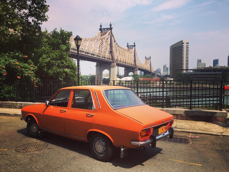 1977 dacia 1300 rear three-quarter urban cityscape background